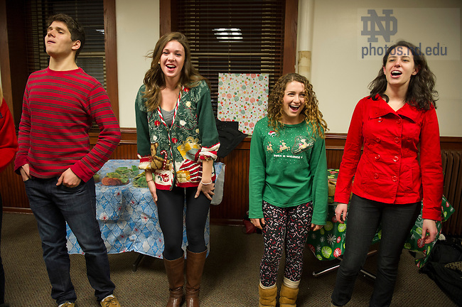 Dec 6, 2013; Members of Halftime A Cappella Choir warm up at Carroll Hall before the Christmas tree lighting celebration. Photo by Barbara Johnston/University Photographer