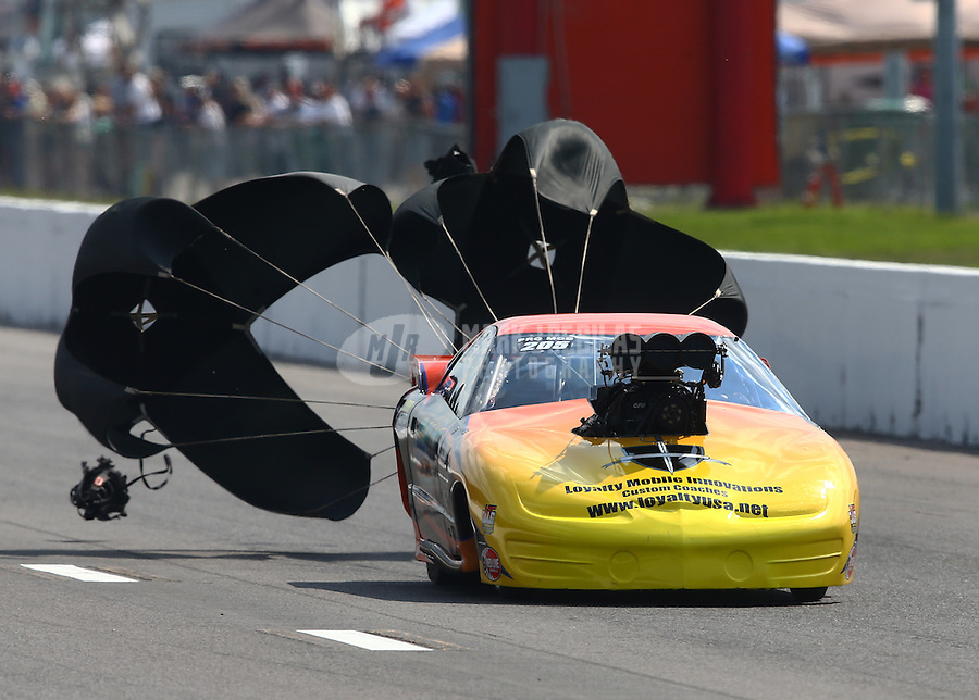 Sep 28, 2013; Madison, IL, USA; NHRA pro mod driver Kevin Rivenbark during qualifying for the Midwest Nationals at Gateway Motorsports Park. Mandatory Credit: Mark J. Rebilas-