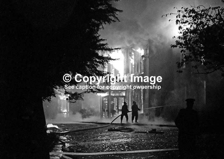 Fireman in action at the scene of the Provisional IRA bombing and subsequent fire at the Woodburn House Hotel on the Stewartstown Road, Belfast, N Ireland, UK, 1971. PLEASE CONTACT ME IF YOU CAN TELL ME EXACT DATE OF INCIDENT. 197100000445c<br /> <br /> Copyright Image from Victor Patterson, 54 Dorchester Park, Belfast, UK, BT9 6RJ<br /> <br /> t1: +44 28 9066 1296<br /> t2: +44 28 9002 2446<br /> m: +44 7802 353836<br /> <br /> e1: victorpatterson@me.com<br /> e2: victorpatterson@gmail.com<br /> <br /> www.victorpatterson.com<br /> <br /> IMPORTANT: Please see my Terms and Conditions of Use at www.victorpatterson.com