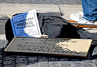 Protest signs in front of an unidentified man playing a guitar on the street in front of the Palau de la Generalitat de Catalunya as he and others advocate for Catalonian independence from Spain on Tuesday, November 7, 2017. The building is a historic palace in Barcelona, Catalonia, that houses the offices of the Presidency of the Generalitat de Catalunya Barcelona. <br /> Credit: Ron Sachs / CNP /MediaPunch