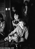 Watching students perform in the Drama Dept, the Education Centre, Wester Hailes, Scotland, 1979.  John Walmsley was Photographer in Residence at the Education Centre for three weeks in 1979.  The Education Centre was, at the time, Scotland's largest purpose built community High School open all day every day for all ages from primary to adults.  The town of Wester Hailes, a few miles to the south west of Edinburgh, was built in the early 1970s mostly of blocks of flats and high rises.