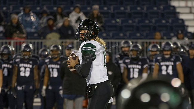 Hawaii quarterback Cole McDonald (13) looks to throw against Nevada in the second half of an NCAA college football game in Reno, Nev. Saturday, Sept. 28, 2019. (AP Photo/Tom R. Smedes)