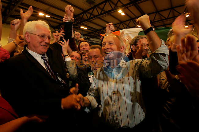 OUt going TD Seamus Kirk and Dermot Ahern hold onto there seats at the Louth Election count in Dundalk ..Photo: Newsfile/Fran Caffrey..