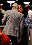 Chip leader .Alessio Isaia gets a kiss from his girlfriend, Claudia Cerantola at the start of play.