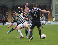 Stuart Kettlewell clears before being tackled by John McGinn with Erik Cikos in attendance in the St Mirren v Ross County Scottish Professional Football League Premiership match played at St Mirren Park, Paisley on 3.5.14.