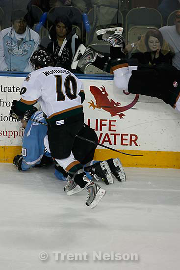 West Valley City - Utah's Mike Walsh (17) flies over Alaska's Colin Hemingway (10), with Utah's Tyler Wooddisse (10) at front, in the first period. Utah Grizzlies vs. Alaska Aces ECHL Hockey, Game 3 of the playoffs at the E Center, Wednesday April 15, 2009..