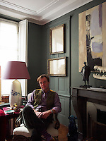 Nicolo Castellini Baldissera in his Paris drawing room beside a  bronze maquette of his great-great grandfather Giacomo Puccini on the mantelpiece