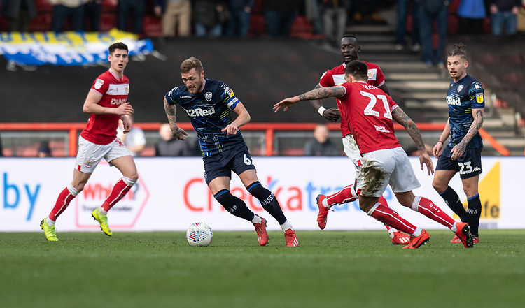 Leeds United's Liam Cooper (centre) under pressure from Bristol City's Marlon Pack (right) <br /> <br /> <br /> Photographer David Horton/CameraSport<br /> <br /> The EFL Sky Bet Championship - Bristol City v Leeds United - Saturday 9th March 2019 - Ashton Gate Stadium - Bristol<br /> <br /> World Copyright © 2019 CameraSport. All rights reserved. 43 Linden Ave. Countesthorpe. Leicester. England. LE8 5PG - Tel: +44 (0) 116 277 4147 - admin@camerasport.com - www.camerasport.com