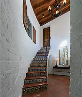 BNPS.co.uk (01202 558833)<br /> Pic: JimBartsch/DouglasElliman<br /> <br /> The Spanish style was popular in the early days of Hollywood.<br /> <br /> Goddesses and Monsters - Hacienda Style home from the halcyon days of Hollywood for sale.<br /> <br /> The enchanting former Beverly Hills home of both film icon Katharine Hepburn, and screen monster Boris Karloff has emerged on the market for £7million. ($8,95m)<br /> <br /> The four-time Oscar winning starlet lived at the 'hacienda' home when she first moved to Hollywood in the early 1930s.<br /> <br /> After finding fame, she sold it to Frankenstein actor Boris Karloff in the mid-1940s who bizarrely was a keen gardener and worked extensively on the landscaping.<br /> <br /> Another famous former owner of the single storey, five bedroom Spanish style residence, which has its own swimming pool and bar, is Animals frontman Eric Burdon, whose House of the Rising Sun, help fund its purchase in the 1960's.<br /> <br /> It is being sold with estate agent Douglas Elliman who describe it as 'a home fit for Hollywood royalty'.