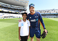 Martin Guptill with the ANZ coin toss winner.<br /> New Zealand Blackcaps v England. 1st day/night test match. Eden Park, Auckland, New Zealand. Day 1, Thursday 22 March 2018. &copy; Copyright Photo: Andrew Cornaga / www.Photosport.nz