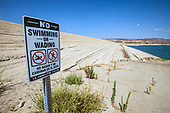 No Swimming or wading sign along incline of Castaic Dam during Summer of 2014. Castaic Lake is at 55% of capacity during California's declared drought State of Emergency.