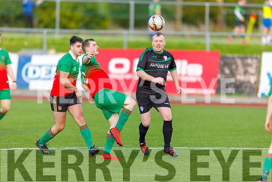 Camp United's Fionn Coakley controls the ball as Rattoo Rovers Michael Hussey puts in the challenge for possession, in Mounthawk Park on Sunday.
