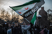 NEW YORK,NY December 16,2016: A man holds a Syrian flag during a vigil to protest against the Syrian government and the killing of innocent people in Washington Square Park, in New York City, December  16,2016. Photo by VIEWpress/Maite H. Mateo