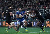 France's Wesley Fofana hands off NZ's Waisake Naholo during the Steinlager Series international rugby match between the New Zealand All Blacks and France at Forsyth Barr Stadium in Wellington, New Zealand on Saturday, 23 June 2018. Photo: Dave Lintott / lintottphoto.co.nz