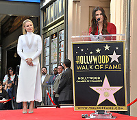 LOS ANGELES, CA. November 19, 2019: Kristen Bell & Idina Menzel at the Hollywood Walk of Fame Star Ceremony honoring Kristen Bell & Idina Menzel.<br /> Pictures: Paul Smith/Featureflash