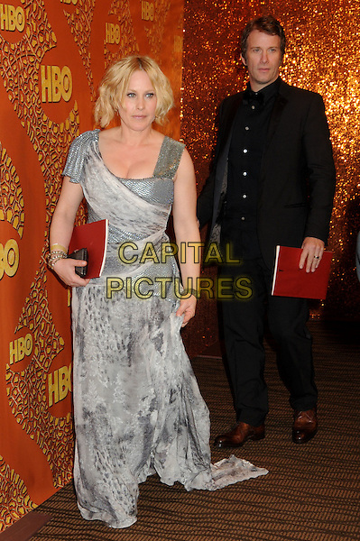 PATRICIA ARQUETTE & THOMAS JANE.HBO's 2010 67th Golden Globe Awards Post Party held at the Beverly Hilton Hotel, Beverly Hills, California, USA..January 17th, 2009.globes full length grey gray dress maxi married husband wife black suit silver print clutch bag .CAP/ADM/BP.©Byron Purvis/Admedia/Capital Pictures