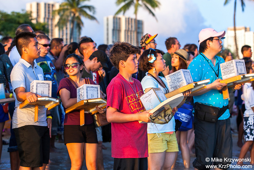 Participants holding lanterns at the 15th annual Lantern Floating Ceremony at Ala Moana Beach Park in Honolulu on Memorial Day