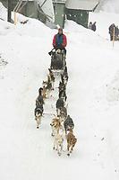 Bryan Mills Leaves Takotna Chkpt During Snow Storm 2005 Iditarod