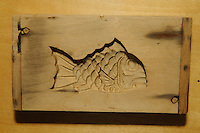 A wooden mold used to make kamaboko in the shape of a fish in the kamaboko museum, Suzuhiro kamaboko, Odawara, Kanagawa prefecture, Japan, August 19, 2009.