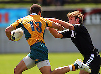 Cameron Mitchell hands off Rhys Llewellyn during the International rugby match between New Zealand Secondary Schools and Suncorp Australia Secondary Schools at Yarrows Stadium, New Plymouth, New Zealand on Friday, 10 October 2008. Photo: Dave Lintott / lintottphoto.co.nz