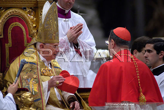 New cardinal Giovanni Lajolo of the Italy. greets Pope Benedict XVI after he received the biretta, a four-cornered red hat, during the Consistory ceremony in Saint Peter's Basilica at the Vatican November 24, 2007. Pope Benedict, elevating 23 prelates from around the world to the elite rank of cardinal, made a pressing appeal on Saturday for an end to the war in Iraq and decried the plight of the country's Christian minority.