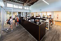 Jack Stabenfeldt '14, head coach of the men's and women's water polo teams<br /> Occidental College's newly remodeled Department of Athletics offices on March 13, 2019.<br /> (Photo by Marc Campos, Occidental College Photographer)