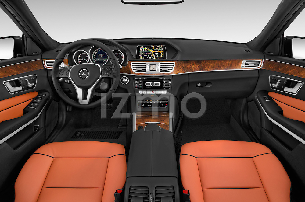 Stock photo of straight dashboard view of a 2015 Mercedes Benz E Class Elegance 4 Door Sedan