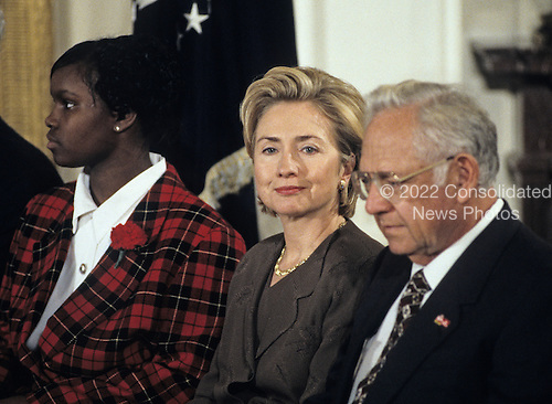 United States President Bill Clinton and first lady Hillary Rodham Clinton host an event in the East Room of the White House advocating expanded use of the internet to place adoptions in Washington, D.C. on November 24, 1998.  From left to right: Charday Mays;  the first lady; and Dave Thomas, founder of Wendy's.<br /> Credit: Ron Sachs / CNP