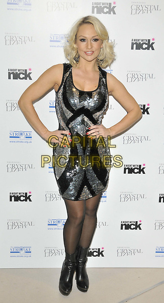 """Kristina Rihanoff.The """"A Night With Nick"""" charity event in aid of The Stroke Association, Swarovski CRYSTALLIZED, Gt. Marlborough St., London, England..December 6th, 2011.full length black silver pattern sequins sequined dress sleeveless hands on hips ankle boots .CAP/CAN.©Can Nguyen/Capital Pictures."""