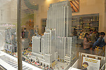 Manhattan, New York, U.S. - May 21, 2014 - In Rockfeller Center, the Lego store has Lego Miniland in its window display, during a pleasant Spring day in Manhattan. The buildings are made from Lego building blocks and include Radio City and the Rockefeller Plaza ice skating rink.