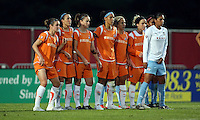 Sky Blue's wall and Chicago's Christiane (9) await a free kick from Chicago's Carli Lloyd (10).  Sky Blue defeated the Chicago Red Stars 1-0 in a mid-week game, Wednesday, June 17, at Yurcak Field.