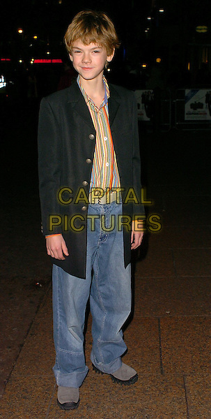 THOMAS SANGSTER.Keeping Mum World Premiere at Vue West End, Leicester Square..London, UK..November 28th, 2005.Ref: CAN.full length striped stripey shirt blue denim jeans black jacket.www.capitalpictures.com.sales@capitalpictures.com.©Capital Pictures