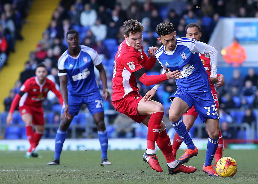 Ipswich Town's Andre Dozzell holds off the challenge from Blackburn Rovers' Sam Gallagher<br /> <br /> Photographer David Shipman/CameraSport<br /> <br /> The EFL Sky Bet Championship - Ipswich Town v Blackburn Rovers - Saturday 14th January 2017 - Portman Road - Ipswich<br /> <br /> World Copyright &copy; 2017 CameraSport. All rights reserved. 43 Linden Ave. Countesthorpe. Leicester. England. LE8 5PG - Tel: +44 (0) 116 277 4147 - admin@camerasport.com - www.camerasport.com
