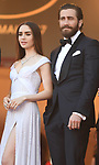 NON EXCLUSIVE PICTURE: MATRIXPICTURES.CO.UK<br /> PLEASE CREDIT ALL USES<br /> <br /> WORLD RIGHTS<br /> <br /> Lily Collins and Jake Gyllenhaal attending the 'Okja' screening, during the 70th Cannes Film Festival, France.<br /> <br /> MAY 20th 2017<br /> <br /> REF: RHD 171023