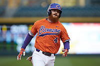 Grayson Byrd (4) of the Clemson Tigers hustles towards third base against the Charlotte 49ers at BB&T BallPark on March 26, 2019 in Charlotte, North Carolina. The Tigers defeated the 49ers 8-5. (Brian Westerholt/Four Seam Images)