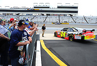 May 1, 2009; Richmond, VA, USA; Fans look on as NASCAR Sprint Cup Series driver Jeff Gordon heads out on track during practice for the Russ Friedman 400 at the Richmond International Raceway. Mandatory Credit: Mark J. Rebilas-