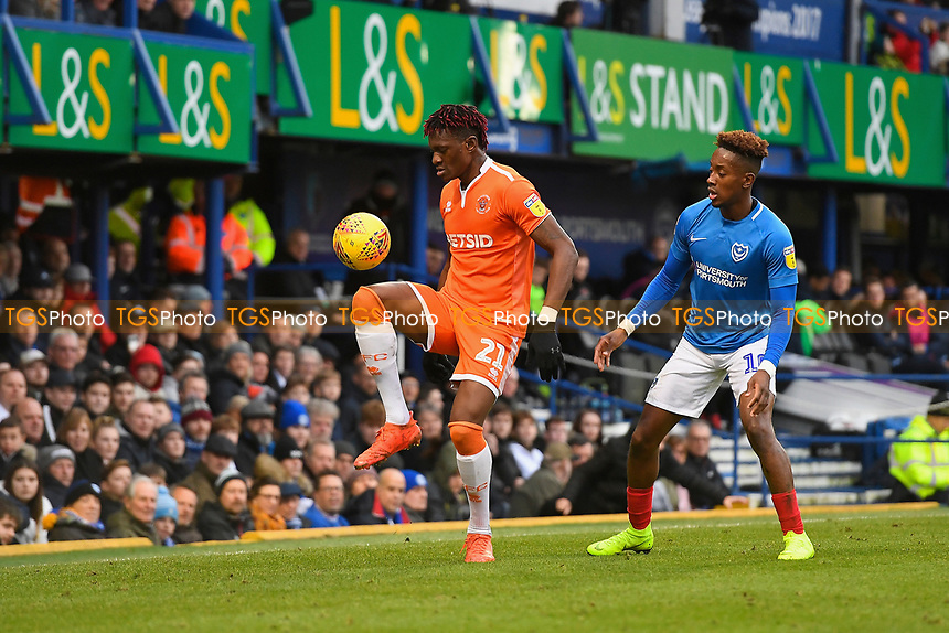 Armand Gnanduillet of Blackpool keeps the ball up ahead of Jamal Lowe of Portsmouth during Portsmouth vs Blackpool, Sky Bet EFL League 1 Football at Fratton Park on 12th January 2019