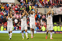 Pictured L-R: Swansea players Leon Britton, Neil Taylor, Kyle Bartley and Jordi Amat thank their away supporters after the final whistle. Sunday 11 May 2014<br /> Re: Barclay's Premier League, Sunderland v Swansea City FC at the Stadium of Light, Sunderland, UK.
