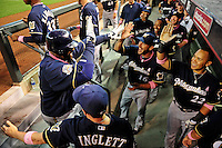 May 9, 2010; Phoenix, AZ, USA; Milwaukee Brewers first baseman Prince Fielder (left) is congratulated by catcher (16) George Kottaras and outfielder (22) Jody Gerut after hitting a home run in the second inning against the Arizona Diamondbacks at Chase Field. Players are wearing pink arm bands and using pink bats in honor of breast cancer awareness and Mothers Day. Mandatory Credit: Mark J. Rebilas-
