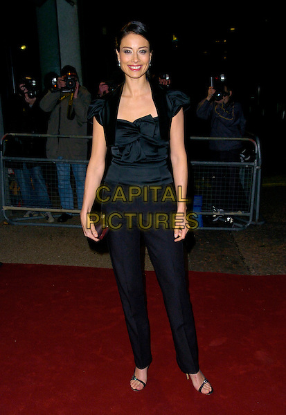 "MELANIE SYKES.Arrives at ""An Audience With Take That"".at The London Television Studios,.London, England, December 2nd 2006..full length black top trousers.CAP/CAN.©Can Nguyen/Capital Pictures"