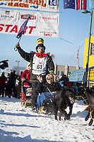 Hugh Neff and team leave the ceremonial start line at 4th Avenue and D street in downtown Anchorage during the 2014 Iditarod race.<br /> Photo by Jim R. Kohl/IditarodPhotos.com