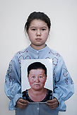 Gulden Muraly holds a photograph of her mother Aygul' Maken. She was arrested on 15.11.2017 in China for her trip to Kazakhstan to her relatives.<br /> <br /> <br /> Мурал Гульден держит фото мамы Айгуль Макен. Она была задержана 15.11.2017 за то, что ездила в Казахстан к родственникам.