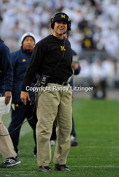 21 November 2015:  Michigan head coach Jim Harbaugh smiles. The Michigan Wolverines defeated the Penn State Nittany Lions 28-16 at Beaver Stadium in State College, PA. (Photo by Randy Litzinger/Icon Sportswire)