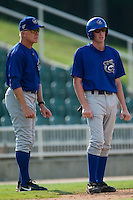 Columbus Manager Jim Morrison (17) gives instructions to Brett Grandstrand (13) as he leads off of third base at Fieldcrest Cannon Stadium in Kannapolis, NC, Sunday, July 22, 2007.
