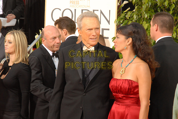 """CLINT EASTWOOD & DINA EASTWOOD.Red Carpet Arrivals - 64th Annual Golden Globe Awards, Beverly Hills HIlton, Beverly Hills, California, USA..January 15th 2007.globes half length husband wife married bow tie red strapless dress.CAP/AW.Please use accompanying story.Supplied by Capital Pictures.© HFPA"""" and """"64th Golden Globe Awards"""""""