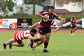 Lage Fasavalu tries to step out of Salesitangi Savelio's tackle. Counties Manukau Premier Club Rugby game between Papakura and Karaka played at Massey Park Papakura on Saturday May 5th 2018. Papakuar won the game 28 - 25 after trailing 6 - 12 at halftime.<br /> Papakura - Faalae Peni, Darryl Hemopo, George Crichton, Federick Cain tries, Faalae Peni conversion; Faalae Peni 2 penalties, Karaka -Salesitangi Savelio, Cardiff Vaega, Walter Fifita tries, Juan Benadie 2 conversions, Juan Benadie 2 penalties.<br /> Photo by Richard Spranger.
