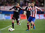 Leverkusen's forward Karim Bellarabi vies with Atletico Madrid's midfielder Mario Suarez during the round of 16 second leg UEFA Champions League football match Atletico de Madrid vs Bayern Leverkusen at the Vicente Calderon stadium in Madrid on March 17, 2015.  PHOTOCALL3000/ DP