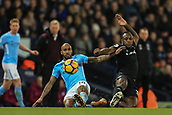 3rd December 2017, Etihad Stadium, Manchester, England; EPL Premier League football, Manchester City versus West Ham United; Fabian Delph of Manchester City slides in to win the ball from Edimilson Fernandes of West Ham