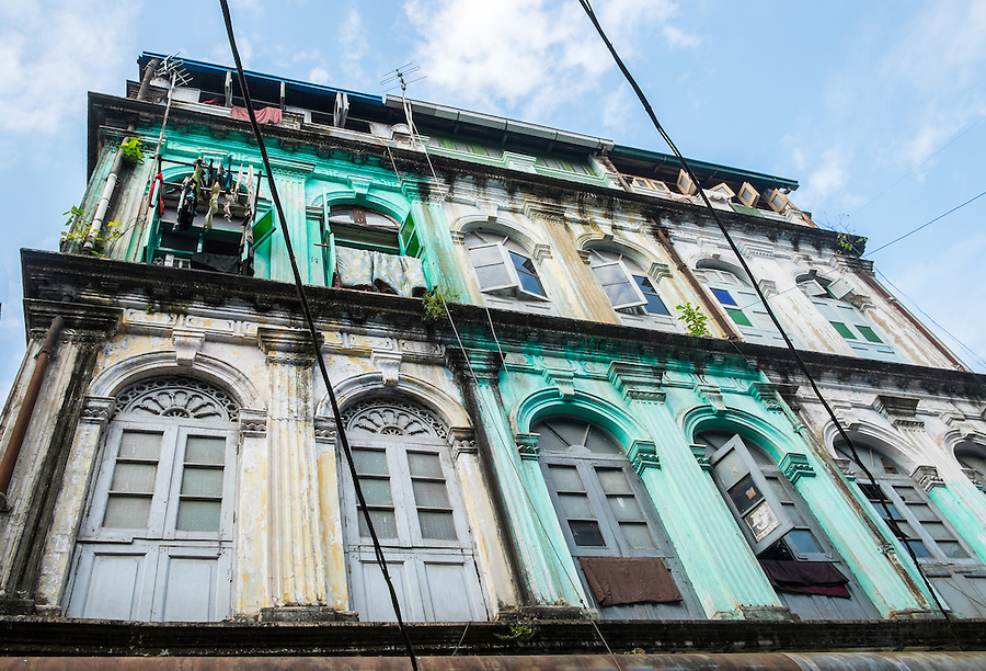 YANGON, MYANMAR - CIRCA DECEMBER 2013: View of typical facade in the streets of Yangon