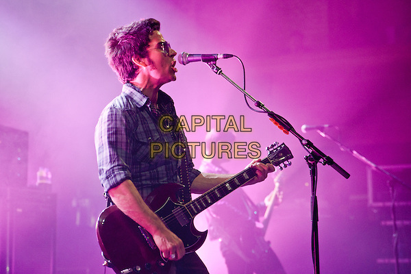 Kelly Jones of The Stereophonics play the Cambridge Corn Exchange, Cambridge, England..July 25th 2012.on stage in concert live gig performance performing music half length singing side profile  guitar checked shirt sunglasses shades .CAP/PP/MM.Mike Mustard/PP/Capital Pictures.